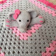 knitted blanket in grey and pink with elephant at the center