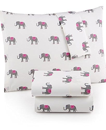 clean white sheets with simple circus elephant pattern