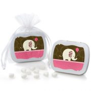 small pink and brown tins with mints in them and elephants on them