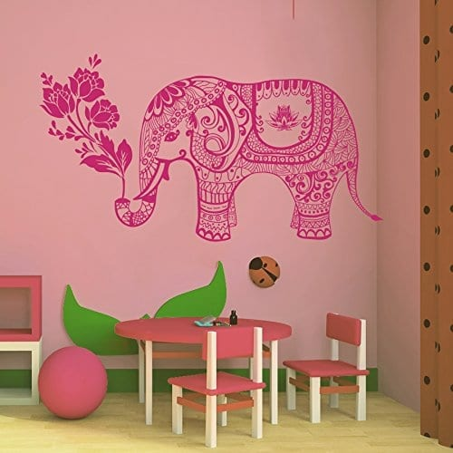 pink elephant with indian pattern holding flowers wall sticker