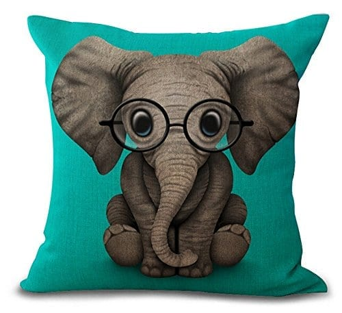 blue cusion with cartoon elephant wearing glasses