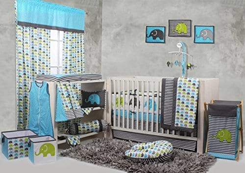 multi piece elephant crib set in blue yellow and black