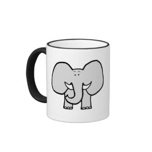 white mug with black handle and grey elephant cartoon