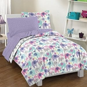 bedding set in purple and white with repeating elephant pattern