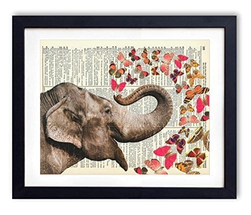picture over elephant and butterflies printed on vintage dictionary page