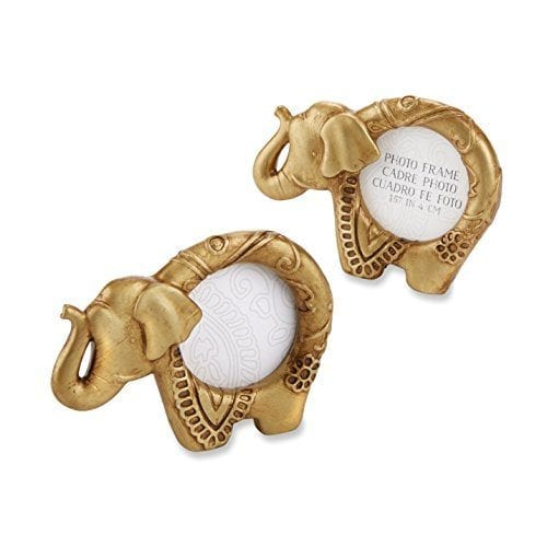 a pair of small golden elephant shaped picture frames