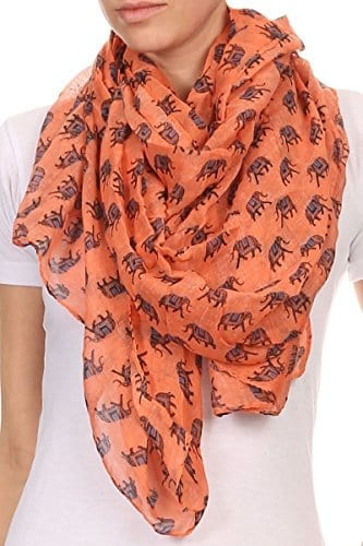 coral thin material scarf with repeating elephant pattern