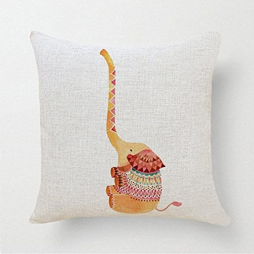 white cushion with brown and red elephant with very long trunk