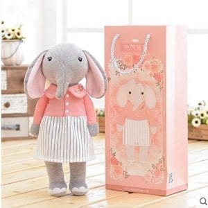 elephant doll wearing pink jacket and skirt