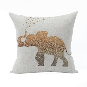 white cusion with speckled gold elephant and stars