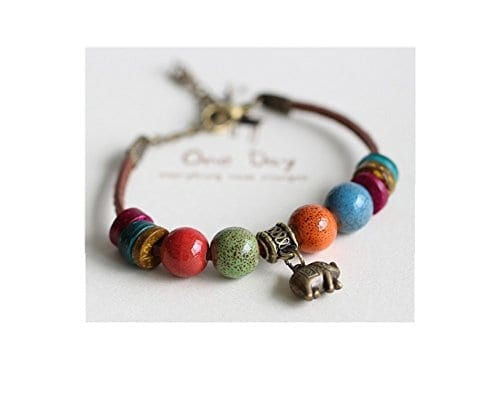 bracelet with various color beads and a small elephant charm