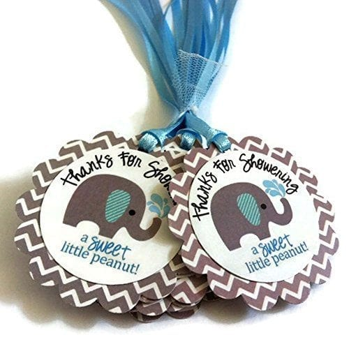 small favor tags with blue ribbons and pictures of elephants