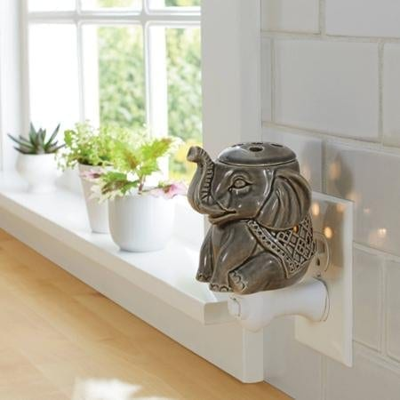 grey green ceramic wax warmer shaped like an elephant