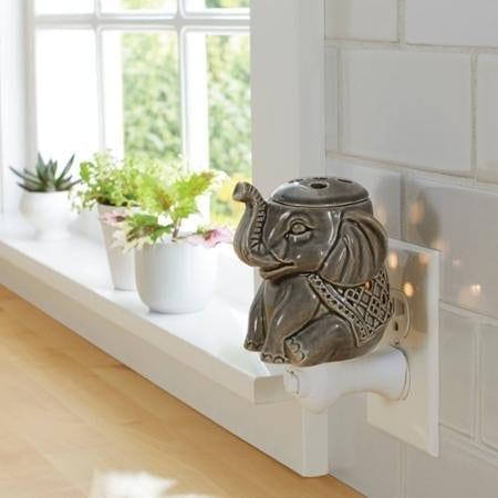 grey green ceramic wax warmer shaped like an elephant