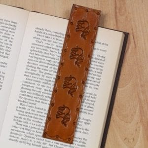 leather bookmark with four elephants and patterned border